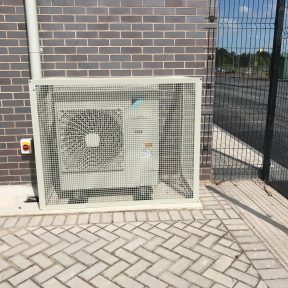 Daikin outside unit installed by Airetch UK ltd protected by a cage - Birmingham